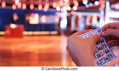 fingers do holes in ticket for game in bingo close up