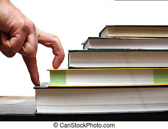 fingers hand up stairs of books. education concept