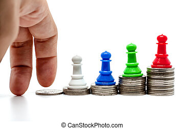 Fingers moving step up the coins with chess pawn on top