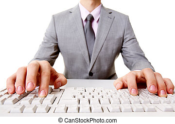 Fingers on keys - Close-up of businessman sitting at the...