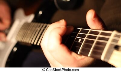 Fingers Play on Electric Guitar - Man playing on electric...