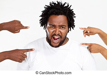 angry overweight african american m - fingers pointing at...