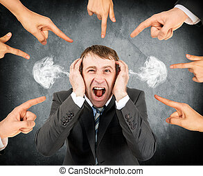 Fingers pointing at screaming stressed businessman