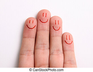 Fingers representing a family drawing happy faces on the...