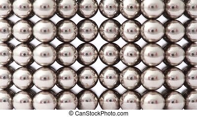 Fingers take structure of magnet balls and divide it - Two...