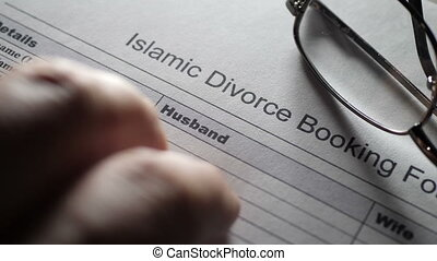 Fingers tapping on islamic divorce form