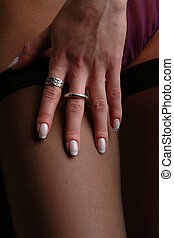 fingertramping - a hand from a lady on a black stocking