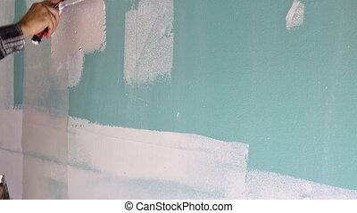 finir, utilisation, outil travail, main, mur, plâtrer