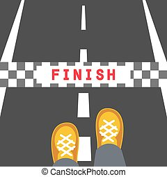 Finish line road sign. Man feets standing on the road in...