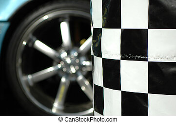Sports car wheel and checkered flag.