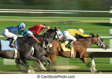 Finish line - Three racing horses neck to neck in fierce...