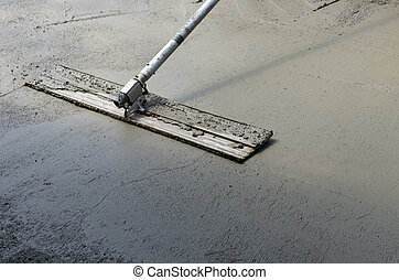 Finishing a concrete floor - Trowel or float used to finish...