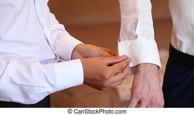 Finishing the Cuff. Cuff with cufflink being put on at wedding