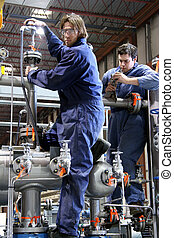 Finishing touch - Two technician working on a...