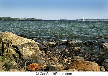 Finland, Baltic sea coast, sailboat on the horizon