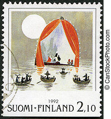FINLAND - CIRCA 1992: A stamp printed in Finland shows Moomin Cartoon Characters, by Tove Jansson: Boats in water, circa 1992