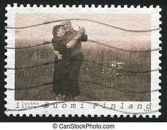 Couple Dancing Tango - FINLAND - CIRCA 1997: stamp printed...