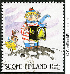 FINLAND - CIRCA 1998: A stamp printed in Finland shows Moomin Cartoon Characters, by Tove Jansson: Organ grinder, circa 1998