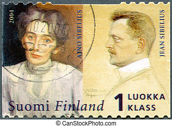 FINLAND - CIRCA 2004: A stamp printed in Finland shows Jean Sibelius (1865-1957) composer, and wife, Aino Sibelius (1871-1969), circa 2004
