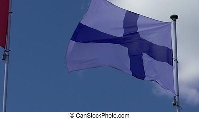 Finland Flag Waving on Blue Sky Background