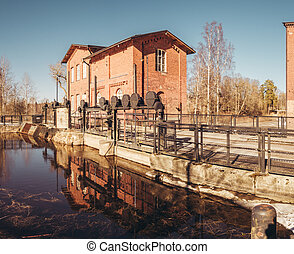 Finland Forssa, the Kuhalankoski dam at the old spinning mill on a spring day. Water is from Loimijoki river