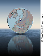 Finland on globe above water surface - Finland with national...