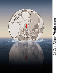 Finland on globe in water - Finland In red on globe floating...