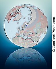 Finland on political globe - Finland with national flag on...
