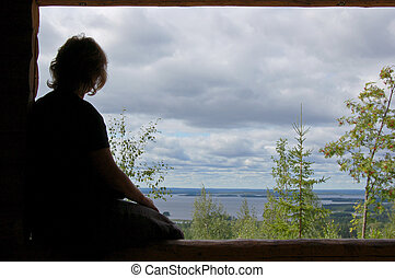 Finnish outlook - Woman at a viewpoint in Finland