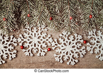 Fir branch and silver shiny snowflakes