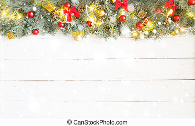Fir branch with Christmas decorations on old wooden shabby background with copy space for text