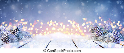Fir Branches And Pinecones On Snowy Table And Christmas Lights