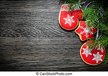 Fir tree branch Christmas cookie on wooden board