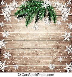 Fir tree branches and snowflakes on the wooden board. ...
