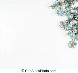 Fir tree branches on white. Card Merry Christmas and Happy New Year with copy space.