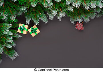 Fir tree branches with Christmas decoration on black wooden background, flat lay. Space for text