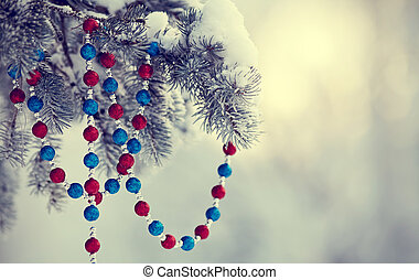 Fir-tree in snow with Christmas-tree decoration
