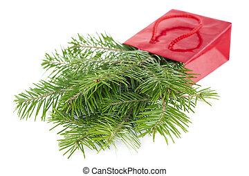 Fir-tree twigs in red paper-bag isolated on white background