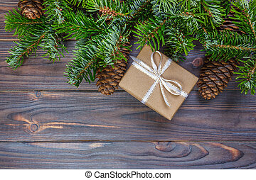 Fir tree with christmas decorations and gift boxes on wooden background