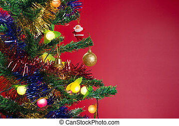 fir tree with Christmas decorations on red