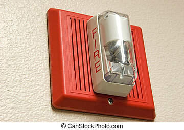 Fire Alarm - Fire alarm light and siren hanging on wall.