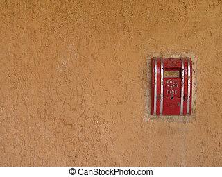 fire alarm on a wall
