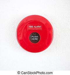 Fire alarm on a white concrete wall