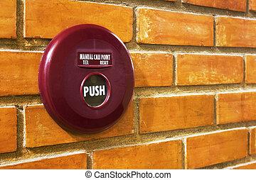 fire alarm on brick wall