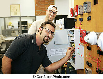 Fire Alarm Repair - Electricians learning to repair fire...