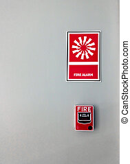 fire alarm signal on wall background.