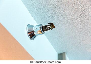 Fire alarm sprinkler on the wall. - Chrome fire alarm...