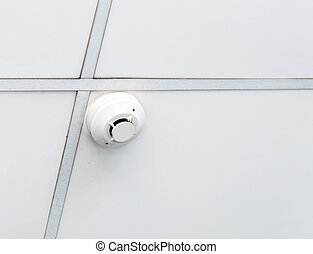 Fire alarm system on the ceiling of small office.