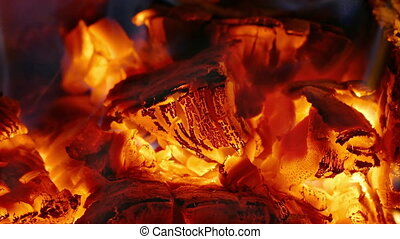 Fire and ember in fireplace - Close up of fire and ember in...