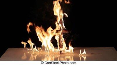 Cross lighting up in flames blazing in the night